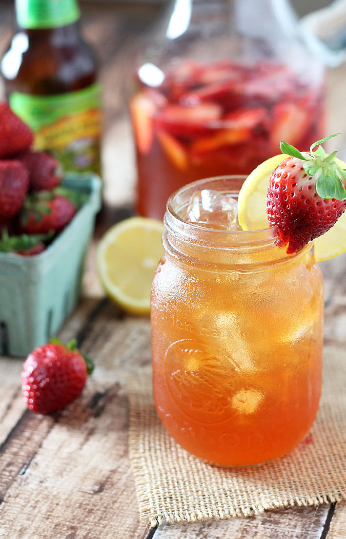 Strawberry Beer Lemonade from The Blond Cook- featured on The Best Lemonade Recipes by cravingsofalunatic.com- Spend your summer sipping all The Best Lemonade Recipes you can get your hands on. Summer is all about refreshing beverages so make the most of it!