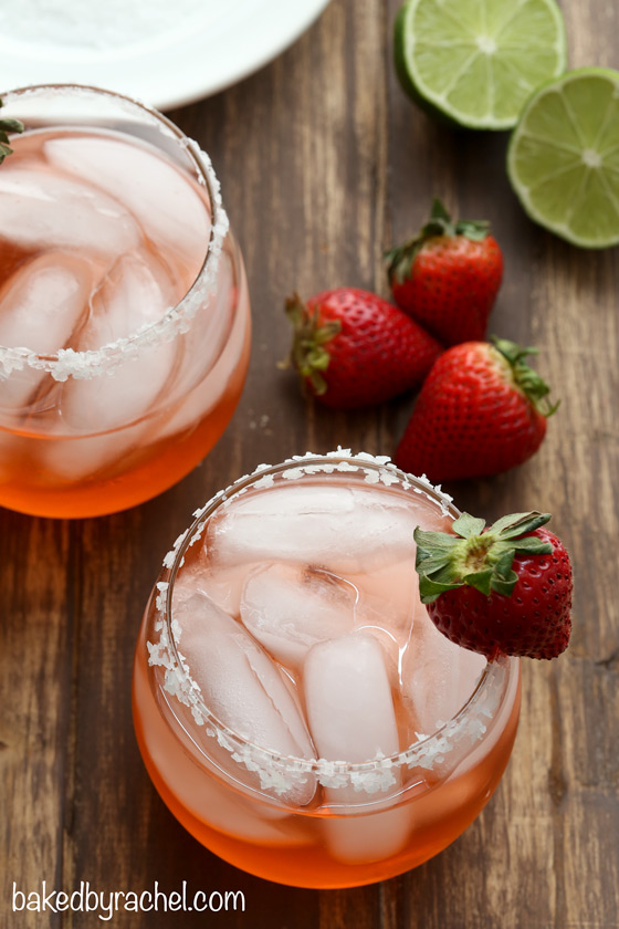Strawberry Margaritas from Baked by Rachel- featured on cravingsofalunatic.com. Kick off the summer season with The Best Margarita Recipes on the block. Sit back, relax, and sip one of these gorgeous margaritas. Or make them all so you can pick your favourite.