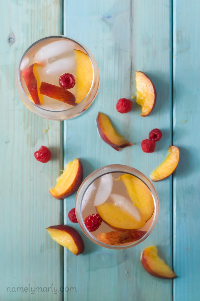Summer Peach Sangria from Namely Marly- featured on The Best Sangria Recipes by cravingsofalunatic.com- Celebrate summer in epic style with The Best Sangria Recipes! Sangria is so easy to make and super versatile. Whip up a batch today!