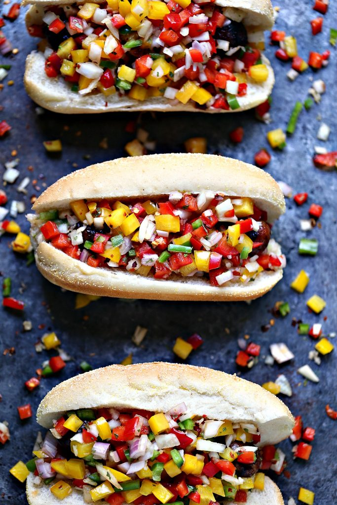 Grilled Beer Brats with Boozy Salsa from cravingsofalunatic.com- Fire up your grill this weekend and make these amazing grilled beer brats. Top with boozy salsa filled with bell peppers, onions, shallots, jalapeno peppers and garlic.