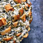 Spinach Artichoke Cheesy Bread. This recipe is chock full of flavor yet remarkably easy to make. The bread is stuffed with spinach artichoke dip and cheese. You need to make this bread immediately.