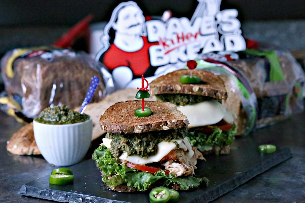 Grilled Chicken Sandwich with Basil Pesto is an easy recipe that will delight your tastebuds. It's piled high with vegetables, chicken, cheese, and pesto.