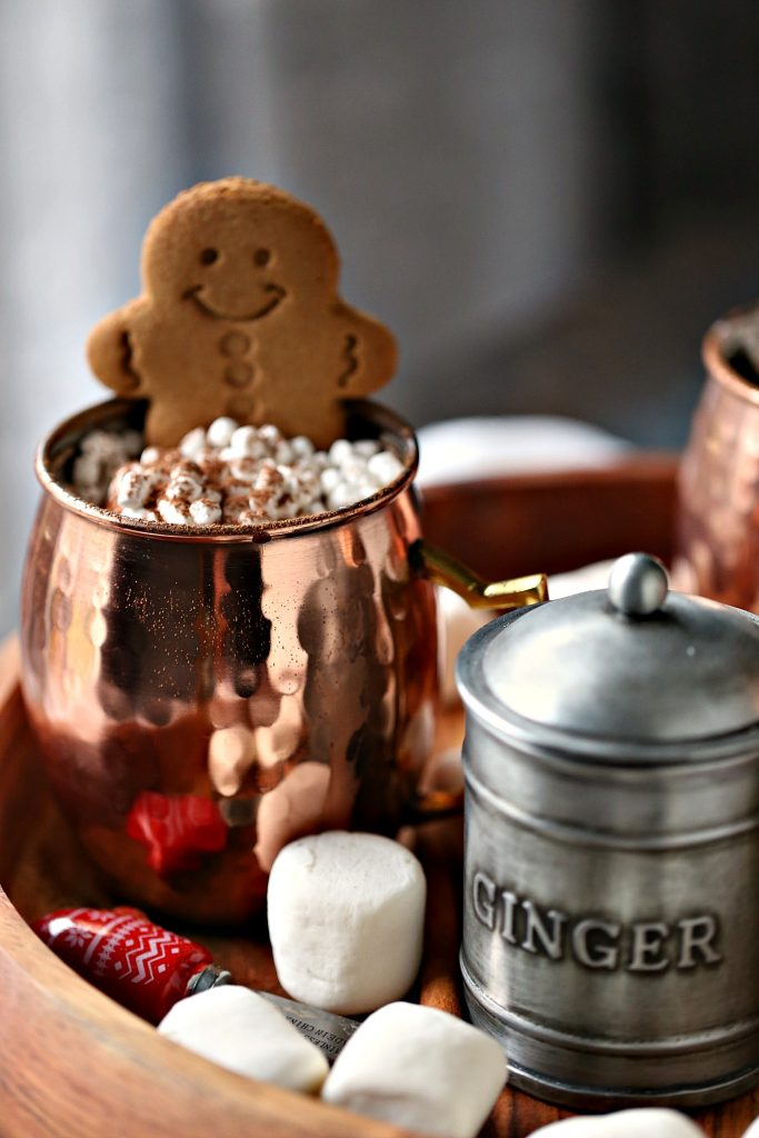 Gingerbread hot chocolate with extra mini marshmallows and a gingerbread cookie.