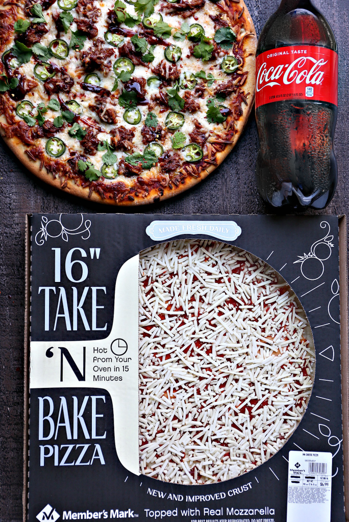 Pressure Cooker Pulled Pork Pizza overhead image of cooked pizza, uncooked pizza in box and a large bottle of Coke.
