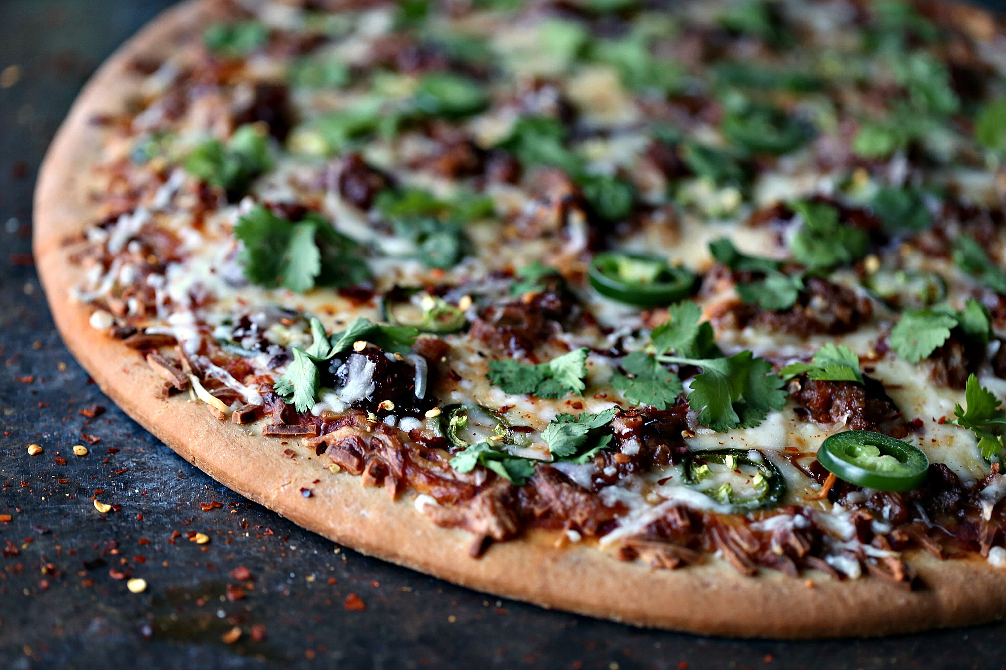 Pressure Cooker Pulled Pork for a Game Day Pulled Pork Pizza. This Pressure Cooker/IP Pulled Pork Recipe is perfect for topping pizza for game day. It's a quick and easy recipe that will help you score a recipe touchdown with all your friends and family.