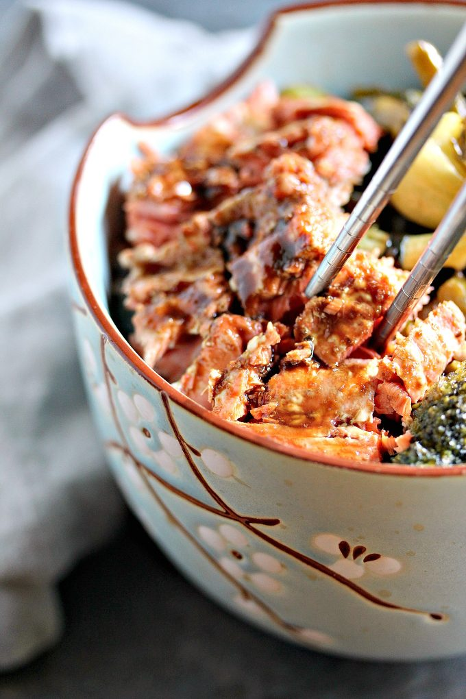 Teriyaki Sockeye Salmon Bowls from Cravings of a Lunatic. This recipe is absolute perfection. Grilled Sockeye Salmon is combined with stir fried vegetables, and made into a delicious bowl recipe. Perfect for lunch, or dinner.