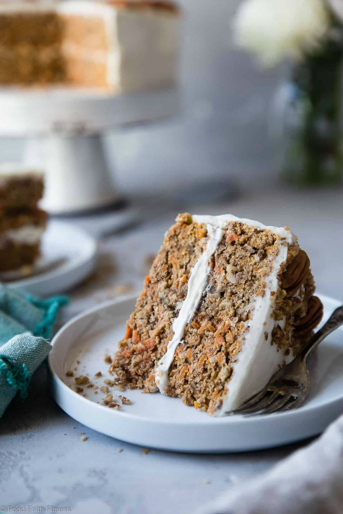 slice of cake on a plate and cake on stand featuring Healthy Gluten Free Sugar Free Carrot Cake from Food Faith Fitness