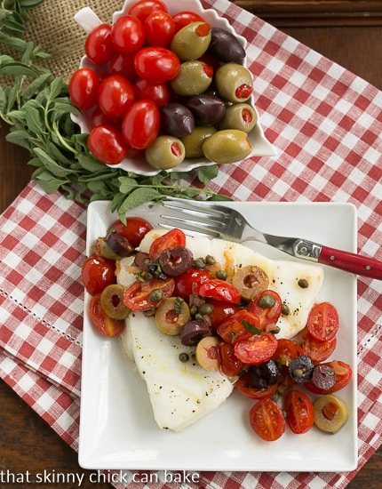 overhead image of Sea Bass with Tomatoes, Olives and Capers from That Skinny Chick Can Bake
