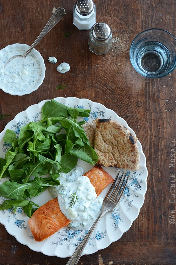 overhead image of Seared Salmon with Tzatziki Sauce from An Edible Mosaic on a wood table