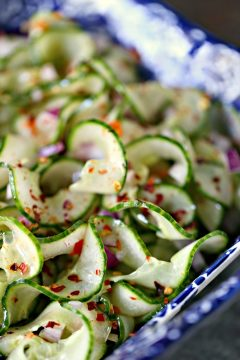 thai cucumber salad in a blue and white bowl