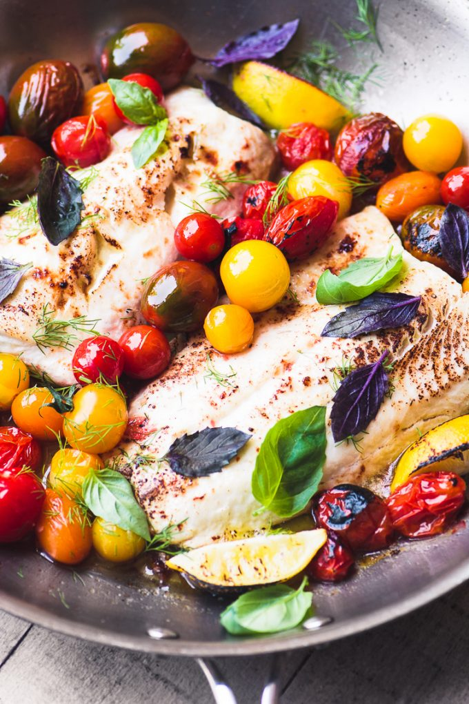 close up image of Easy Whitefish with Burst Cherry Tomatoes and Basil from The View From Great Island in pan