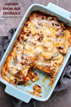 Chicken Enchilada Casserole in a blue serving dish on a grey napkin