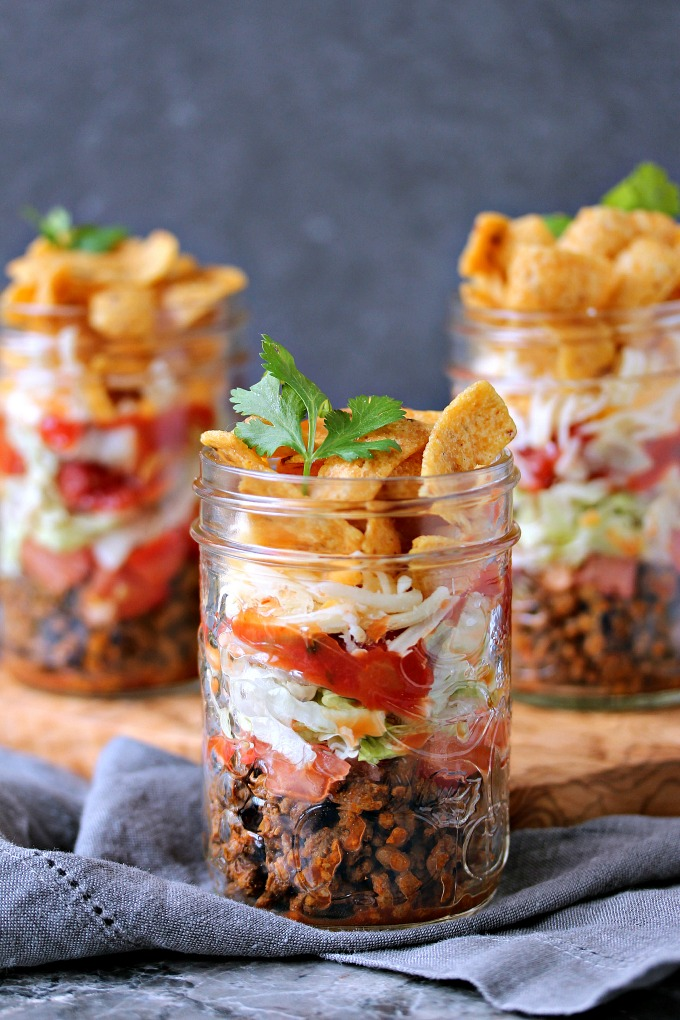 Mini Frito Taco Salads served in individual mason jars