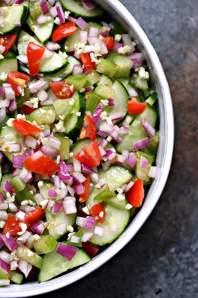 overhead image of cucumber salad with meyer lemon vinaigrette in a white bowl