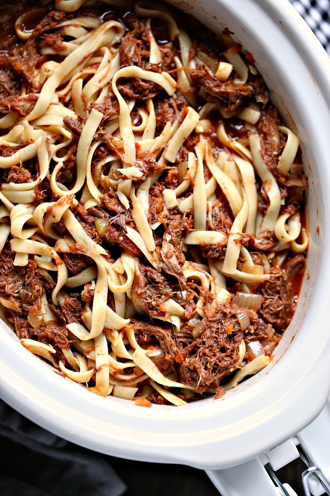 overhead image of slow cooker short rib ragu in white crock