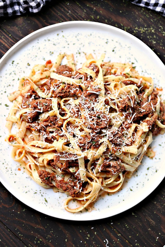 overhead image of slow cooker short rib ragu served on a white plate