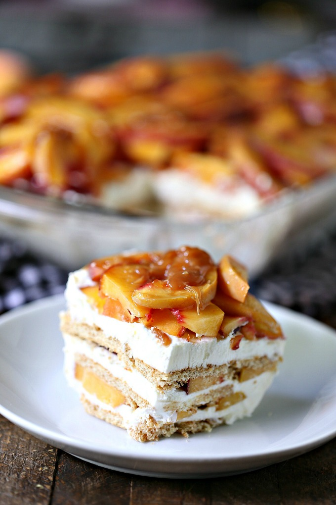 Slice of Peach Icebox Cake with Easy Caramel Sauce on a plate.