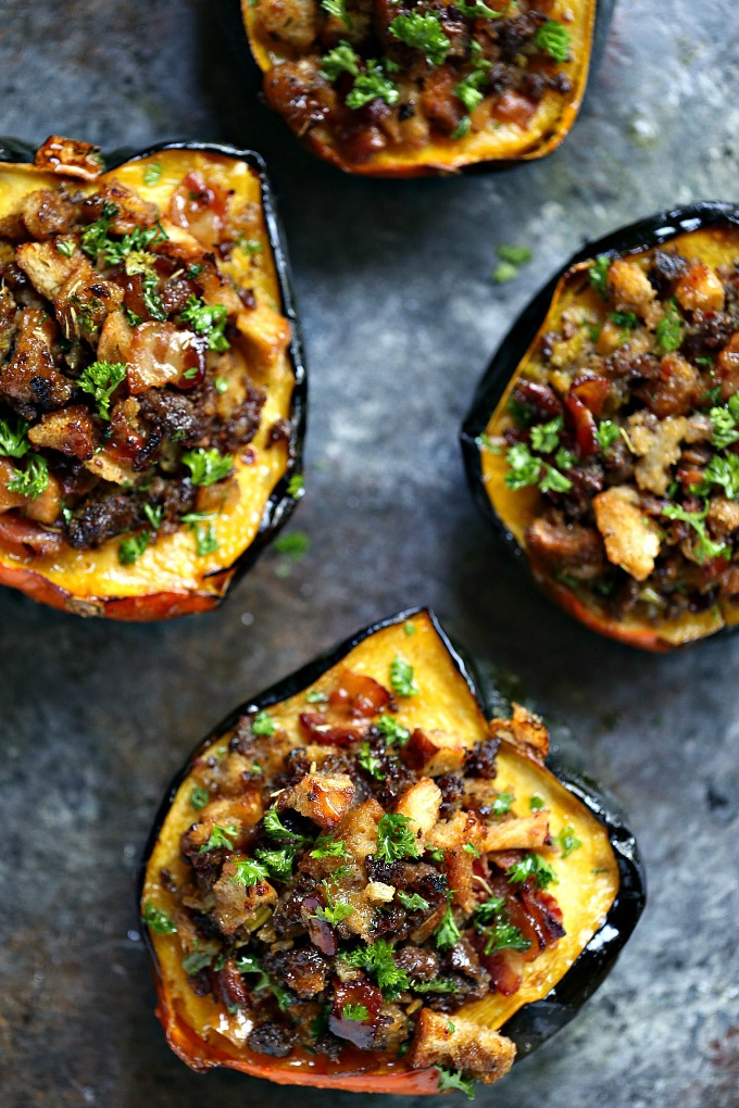 Stuffed Acorn Squash recipe packed with filling made from bacon, Italian sausage, bread crumbs and drizzles of honey!
