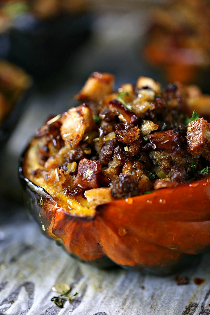 Stuffed Acorn Squash loaded with lots of bacon, Italian sausage, bread crumbs, spices and drizzled with honey! Perfect for Fall!
