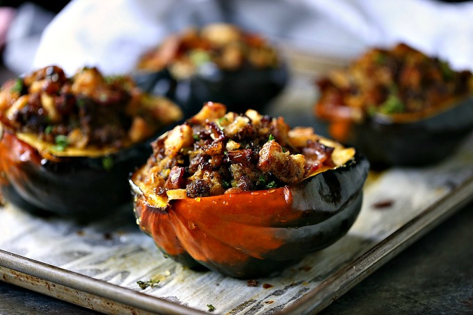 Stuffed Acorn Squash recipe that is baked then stuffed with a filling chock full of bacon, sausage, bread, spices and a hint of honey!