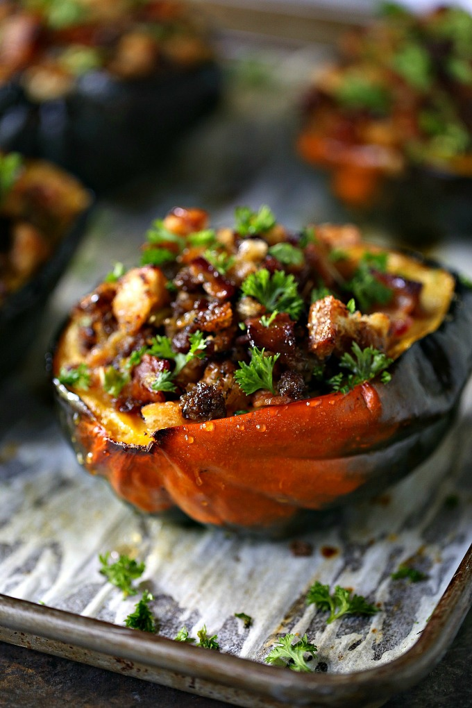 Stuffed Acorn Squash Recipe cooked on a baking sheet and stuffed with filling made from bacon, Italian sausage, bread crumbs and little drizzles of honey!