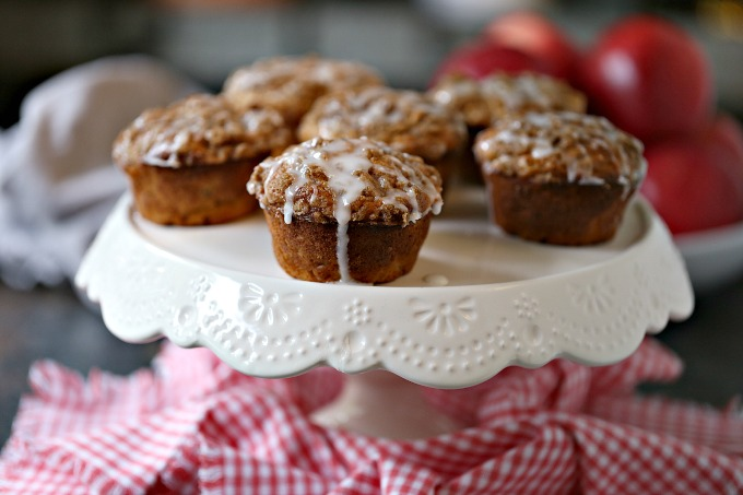 Cookie Butter Apple Cinnamon Muffins covered with Streusel Topping served on a cake stand!