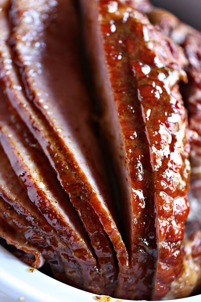 Slow Cooker Ham with Honey Mustard Glaze in a slow cooker getting glazed!