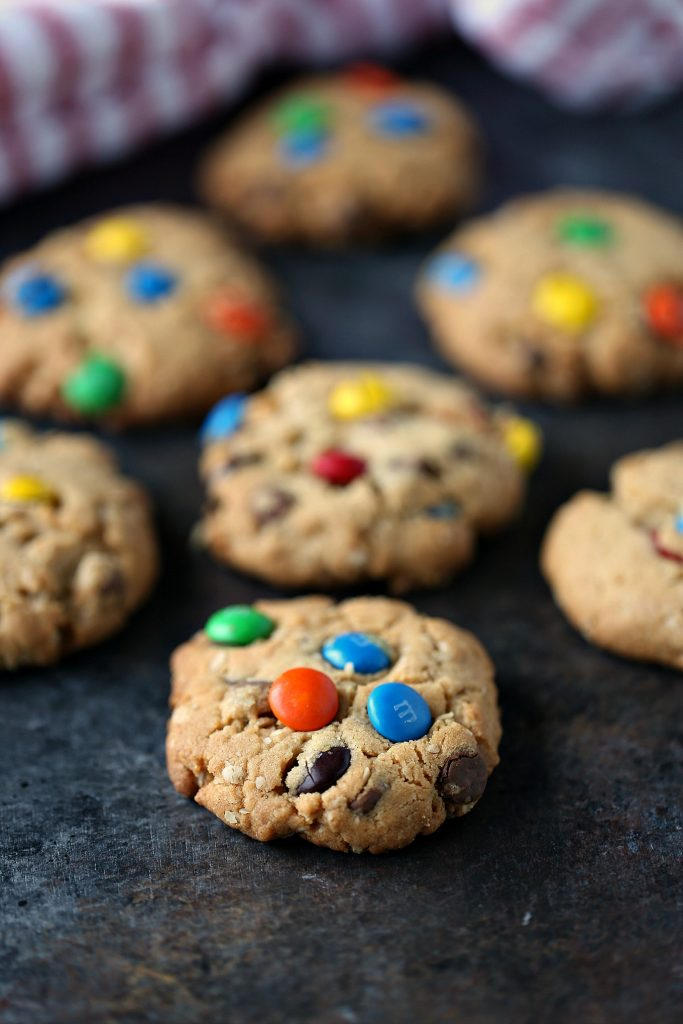 monster cookies on a dark background with a napkin in the background