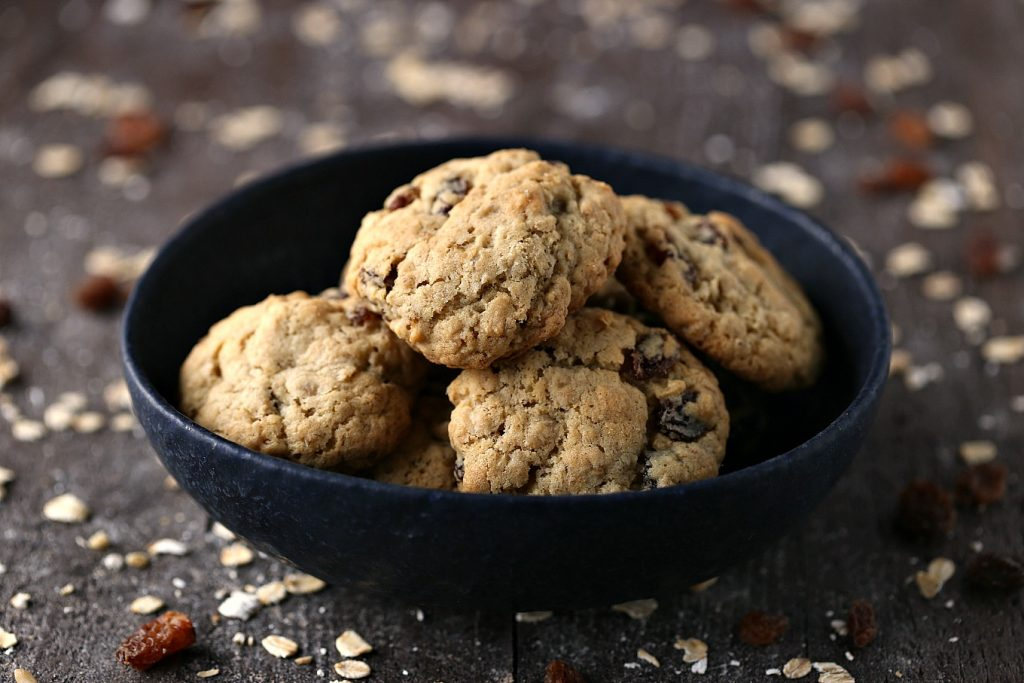 Oatmeal Raisin Cookies in a black bowl.