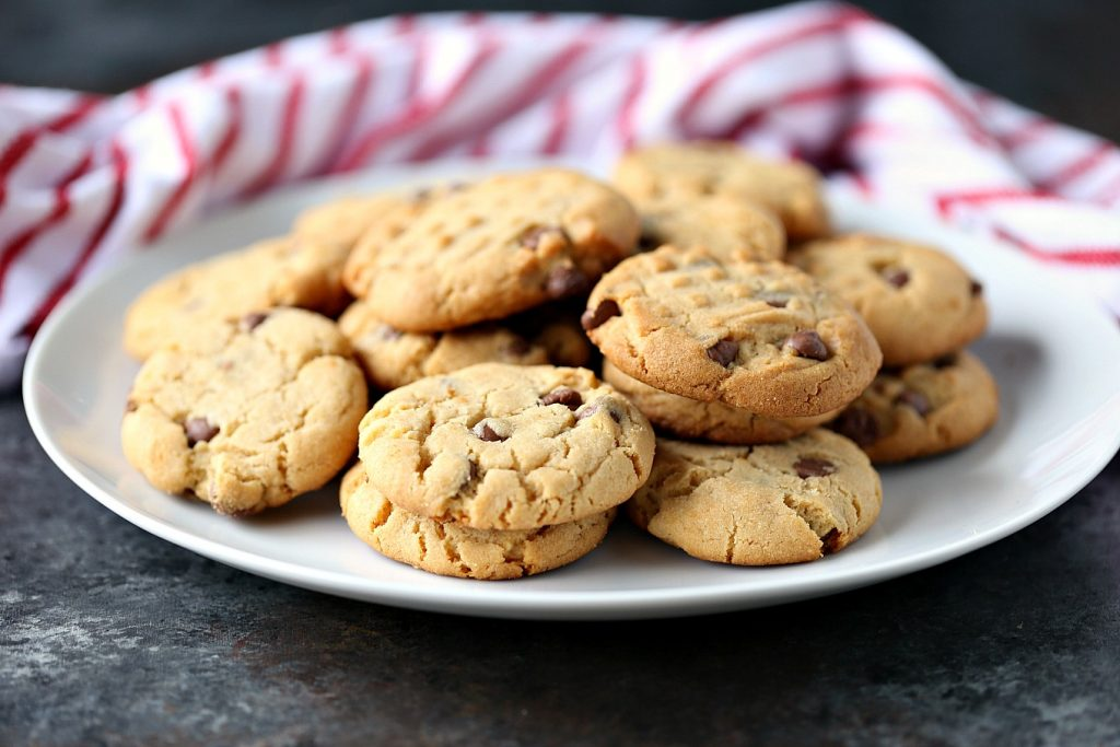 cookies on a white plate with a red and white napkin in the background