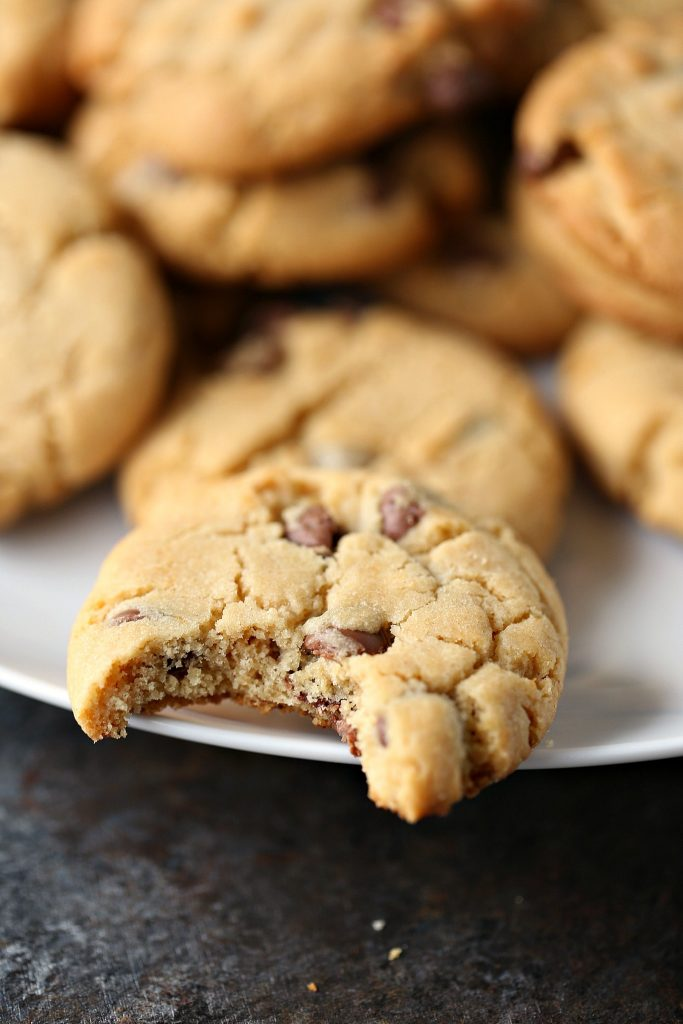 cookies on a white plate, one has a bite out of it
