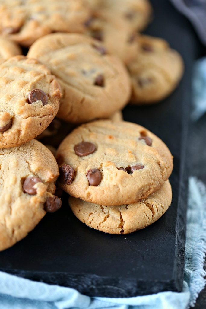 Peanut Butter Chocolate Chip Cookies on a plate plate with a blue napkin under it.