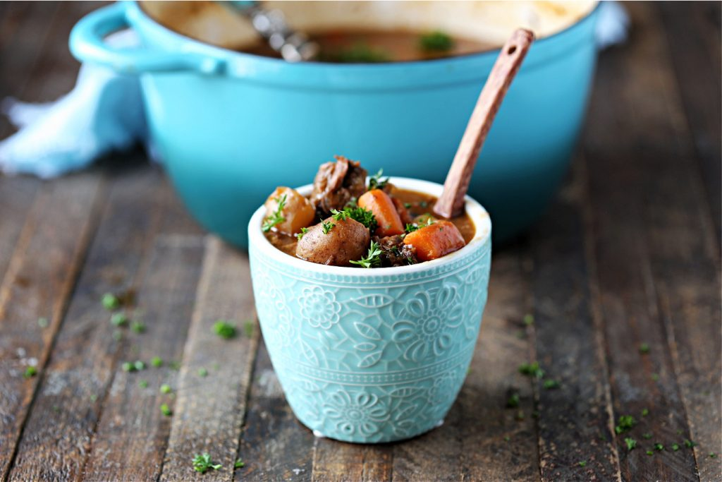 Guinness Beef Stew served in a blue bowl